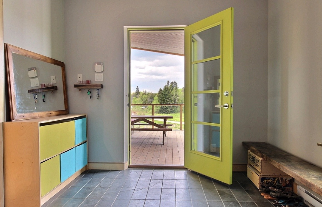Front door of passive farm house in Wakefield Quebec