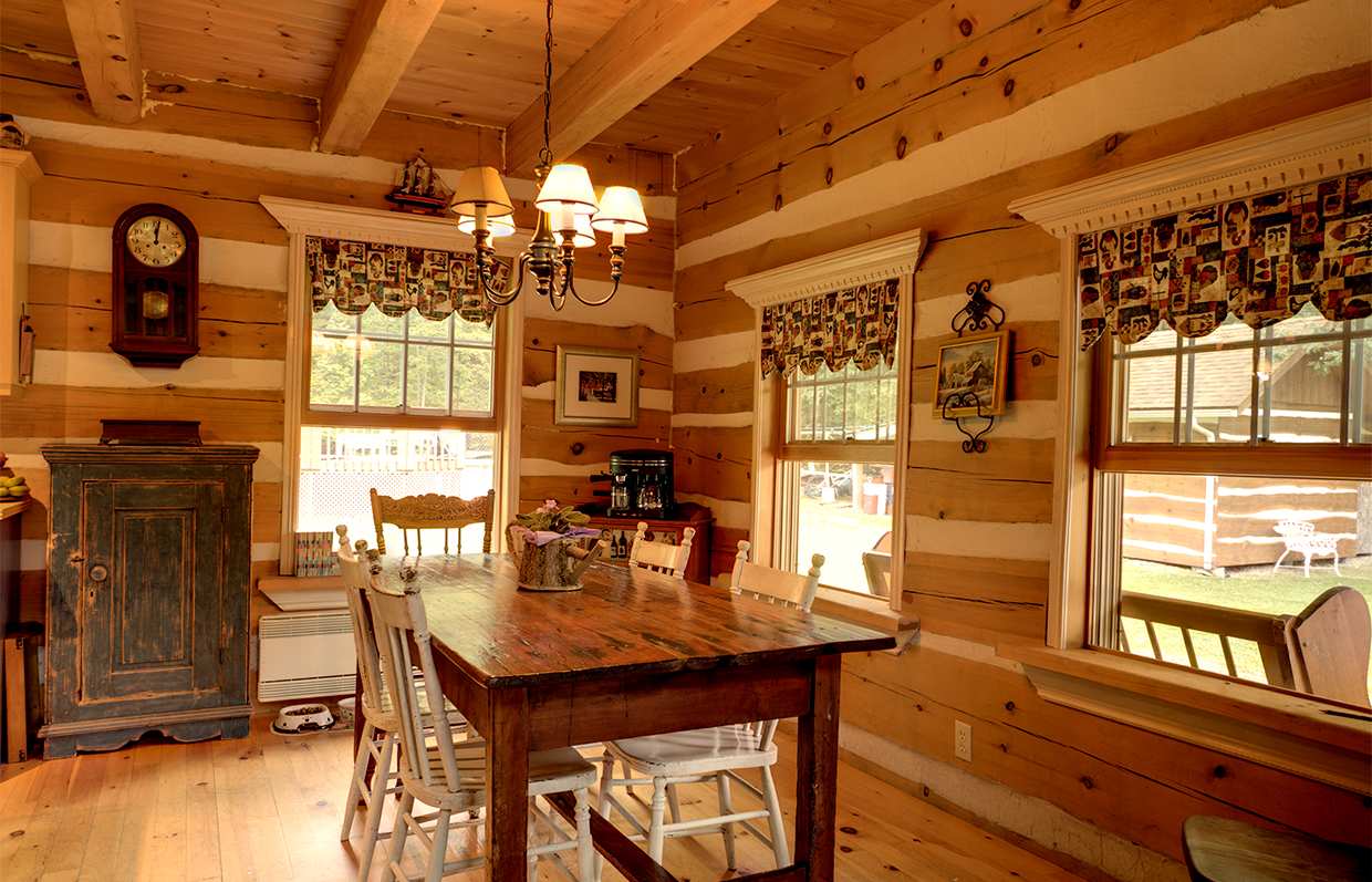 Dinning area of log house in Val-Des-Monts Quebec